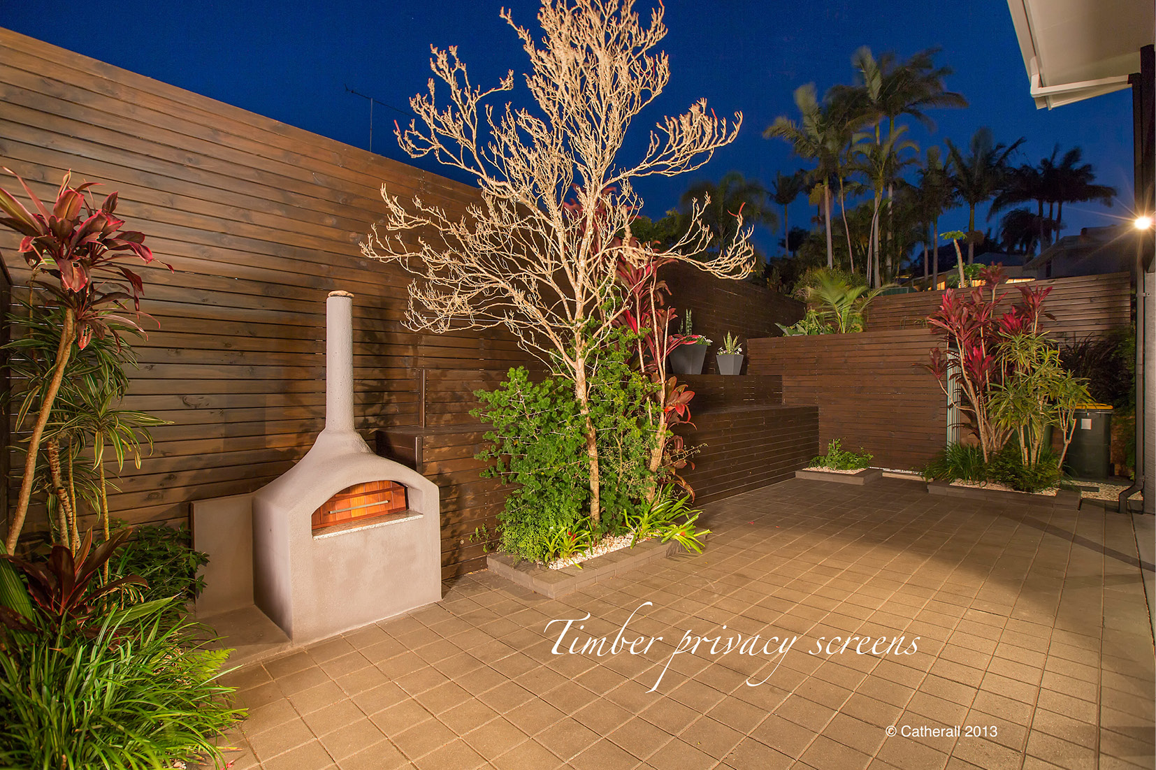 Sunshine Coast Structural Landscaping with timber privacy screens in this courtyard